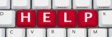 A computer keyboard with red keys spelling Help, Computer Help